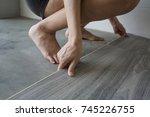 woman laying pvc floor | Shutterstock . vector #745226755