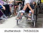 man sitting on the wheel chair... | Shutterstock . vector #745263226