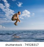 Man Jumping Into The See