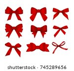 set of red gift bows.  concept... | Shutterstock .eps vector #745289656