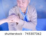 Small photo of Touching hands Asian senior or elderly old woman patient with love, care, hope, encourage and empathy at hospital