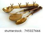 antique brass kitchen utensils...   Shutterstock . vector #745327666