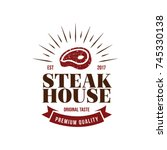 steak house logo. meat symbol... | Shutterstock .eps vector #745330138