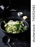 green spinach pasta with cheese ...   Shutterstock . vector #745352482