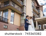 newlywed couple hugging and... | Shutterstock . vector #745365382