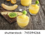 glasses of fresh melon smoothie ... | Shutterstock . vector #745394266