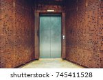 single elevator door outside... | Shutterstock . vector #745411528