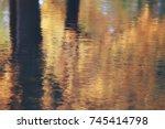 pond in an autumn park  ...   Shutterstock . vector #745414798