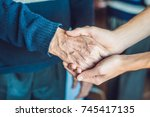 hands of an old woman and a... | Shutterstock . vector #745417135