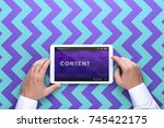 man holding tablet in hand....
