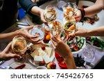 glasses of white wine seen... | Shutterstock . vector #745426765