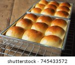 dinner roll bread on wood | Shutterstock . vector #745433572