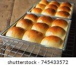 dinner roll bread on wood   Shutterstock . vector #745433572