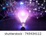 abstract glowing purple lamp... | Shutterstock . vector #745434112