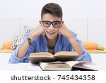 preadolescent child studying... | Shutterstock . vector #745434358