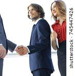 Small photo of Young businessman shaking hands after agree to collaborate.