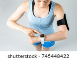 young woman with wearable... | Shutterstock . vector #745448422
