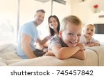 parents with their two children  | Shutterstock . vector #745457842