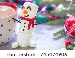 red mug with hot chocolate with ... | Shutterstock . vector #745474906