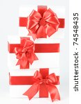 boxes with red ribbons on white | Shutterstock . vector #74548435