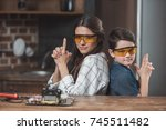 little son and his beautiful... | Shutterstock . vector #745511482