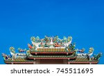 dragon statues on top of temple ... | Shutterstock . vector #745511695