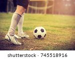 close up soccer player hits a... | Shutterstock . vector #745518916
