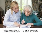 woman helping senior neighbor... | Shutterstock . vector #745519105