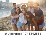 group of happy friends taking... | Shutterstock . vector #745542556