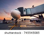 busy airport at the colorful... | Shutterstock . vector #745545085