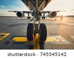 airport at the amazing sunset.... | Shutterstock . vector #745545142