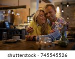 couple embracing in cafe   Shutterstock . vector #745545526