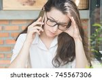 unhappy young woman using her... | Shutterstock . vector #745567306