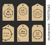 christmas gift tags with hand... | Shutterstock .eps vector #745570162