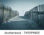 sandy beach path with wooden... | Shutterstock . vector #745599805
