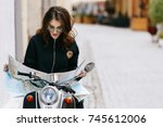 woman in original sunglasses... | Shutterstock . vector #745612006