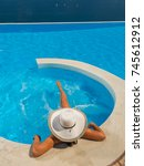 Woman With Hat At The Swimming...