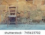The Old Chair Stands Near The...