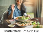 closeup of a woman eating... | Shutterstock . vector #745644112