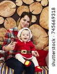 child in costume santa claus   Shutterstock . vector #745669318