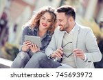 happy young loving couple... | Shutterstock . vector #745693972