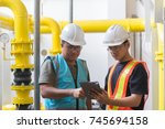 two asian engineer working in... | Shutterstock . vector #745694158
