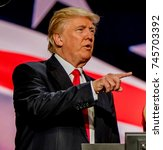 Small photo of Cleveland Ohio, USA, 21th July , 2016 Donald Trump on stage during the sound checks in Quicken Arena for the Republican National Convention