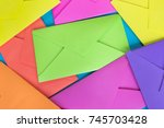 colorful envelopes on the blue... | Shutterstock . vector #745703428