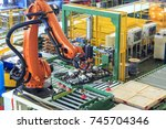 industrial picking robot in... | Shutterstock . vector #745704346