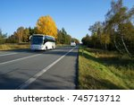 two white buses traveling on... | Shutterstock . vector #745713712