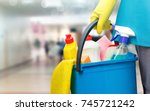 cleaning lady with a bucket and ... | Shutterstock . vector #745721242