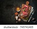 sliced medium rare grilled beef ... | Shutterstock . vector #745741405
