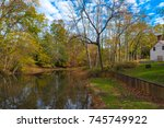 a stream in a woods surrounded... | Shutterstock . vector #745749922