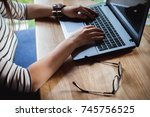 business woman typing on the... | Shutterstock . vector #745756525